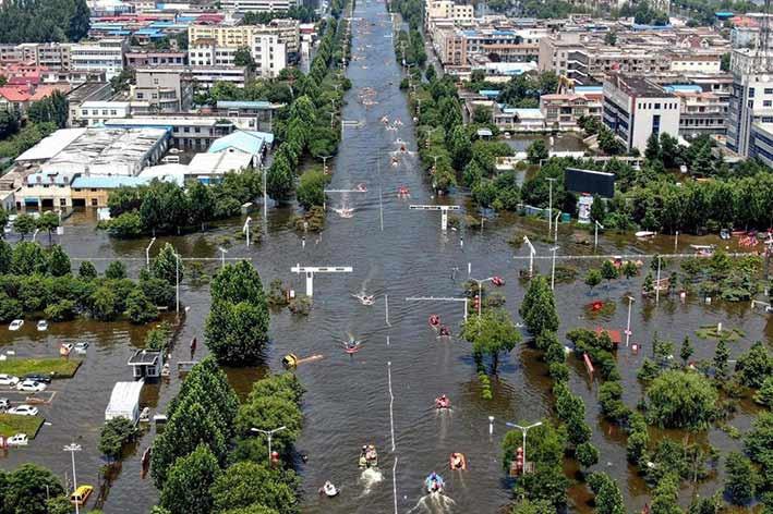 Banjir yang terjadi di Provinsi Henan, Juli 2021. FOTO: AFP VIA SCMP.COM